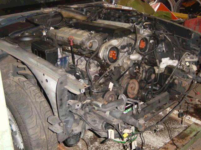 the 2 loose alumium pipes right in front of the engine are from the a/c  condensor connection  notice the heavy shock absorpers of the front bumper: